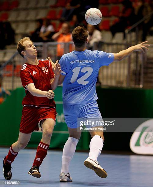 A player of Holzpfosten Schwerte and a player of VfR Ittersbach battle for the ball during the 3rd place match of the DFB Futsal Cup at ring arena on...
