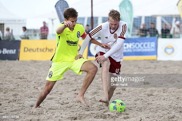 Player of Ibbenbuerener and Player of Duesseldorf compete for the ball during the final match match between Ibbenbuerener BSC and Beach Royals...