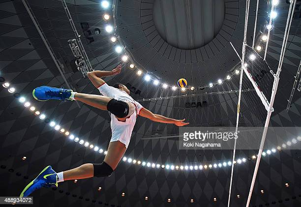 A player of Iran spikes before the match against Japan during the FIVB Men's Volleyball World Cup Japan 2015 at the Osaka Municipal Central Gymnasium...
