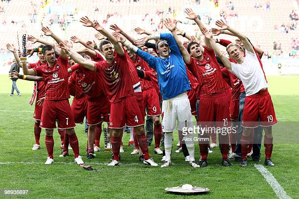 Player of Kaiserslautern celebrate with the championship trophy in front of their supporters after the Second Bundesliga match between 1. FC...