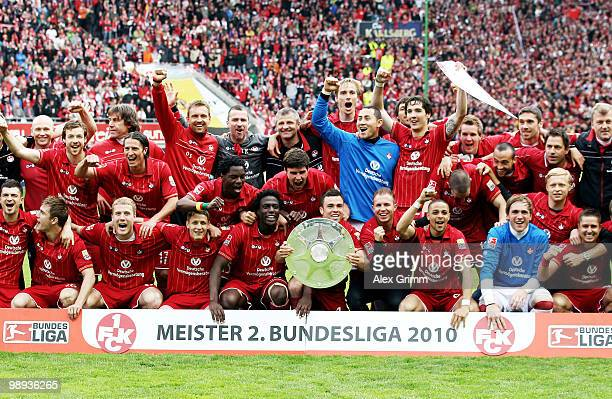 Player of Kaiserslautern pose with the championship trophy after the Second Bundesliga match between 1. FC Kaiserslautern and FC Augsburg at the...