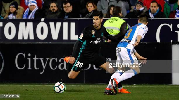 A player of Leganes and Marco Asensio of Real Madrid battle for the ball during the La Liga match between CD Leganes and Real Madrid at Estadio...