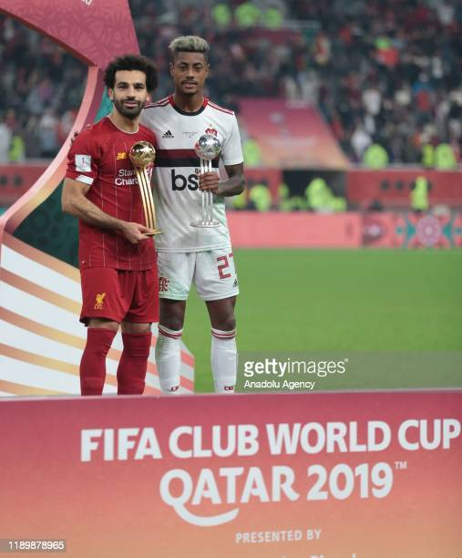 Player of Liverpool Mohamed Salah and player of Flamengo Bruno Henrique pose for a photo during the cup ceremony at the end of the FIFA Club World...