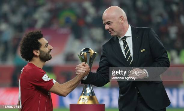 Player of Liverpool Mohamed Salah receives Winner's Trophy from President of FIFA Gianni Infantino at the end of the FIFA Club World Cup Qatar 2019...
