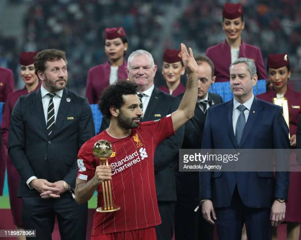Player of Liverpool Mohamed Salah receives Winner's Trophy from President of FIFA Gianni Infantino and Sheikh Joaan bin Hamad bin Khalifa AlThani at...