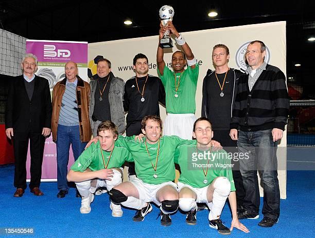 Player of MTV Stuttgart celebrates after winning the Blind Football Bundesliga Indoor Trophy at Soccer Five Arena on December 10 2011 in...