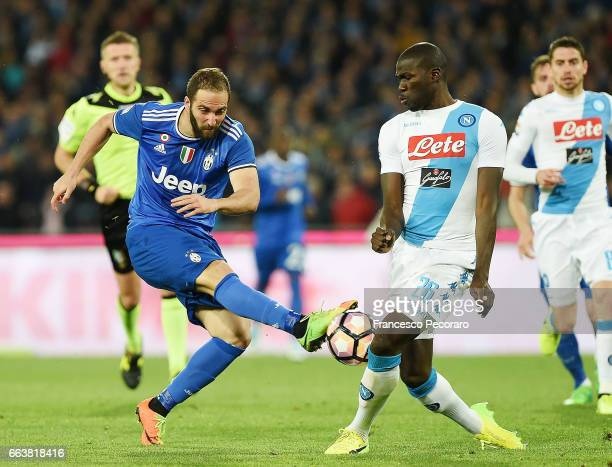 Player of Napoli Kalidou Koulibaly vies with Juventus FC player Gonzalo Higuain during the Serie A match between SSC Napoli and Juventus FC at Stadio...