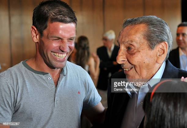 Player of Peñarol Antonio Pacheco and Alcides Edgardo Ghiggia smile durin the FIFA World Cup Trophy event at LATU on January 16 2013 in Montevideo...