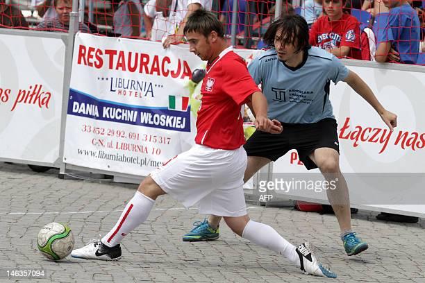 A player of Poland's homeless football team controls the ball during a street football tournament in Cieszyn on June 11 2012 Homeless football world...