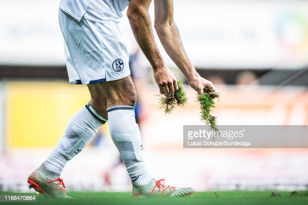 A player of Schalke takes a piece of the pitch during the Bundesliga match between SC Paderborn 07 and FC Schalke 04 at Benteler Arena on September...