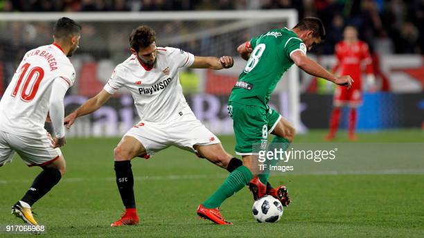 A player of Sevilla and Gabriel Pires of Leganes battle for the ball during the Copa del Rey semifinal second leg match between Sevilla FC and CD...