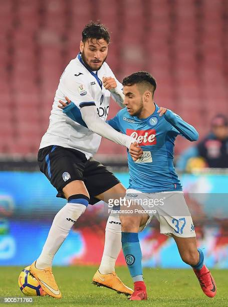 Player of SSC Napoli Adam Ounas vies with Atalanta BC player Rafael Toloi during the TIM Cup match between SSC Napoli and Atalanta BC on January 2...