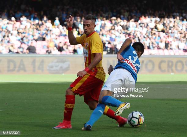 Player of SSC Napoli Adam Ounas vies with Benevento Calcio player Gaetano Letizia during the Serie A match between SSC Napoli and Benevento Calcio at...