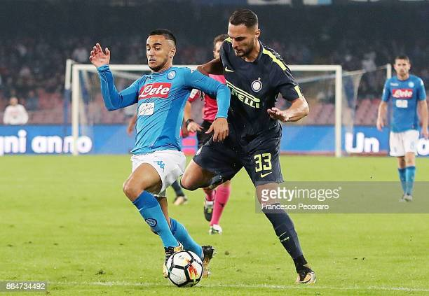 Player of SSC Napoli Adam Ounas vies with FC Internazionale player Danilo D'Ambrosio during the Serie A match between SSC Napoli and FC...