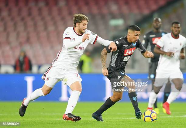 Player of SSC Napoli Allan vies with AC Milan player Manuel Locatelli during the Serie A match between SSC Napoli and AC Milan at Stadio San Paolo on...