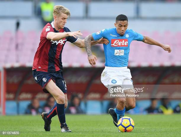 Player of SSC Napoli Allan vies with Bologna FC player Filip Helander during the serie A match between SSC Napoli and Bologna FC at Stadio San Paolo...