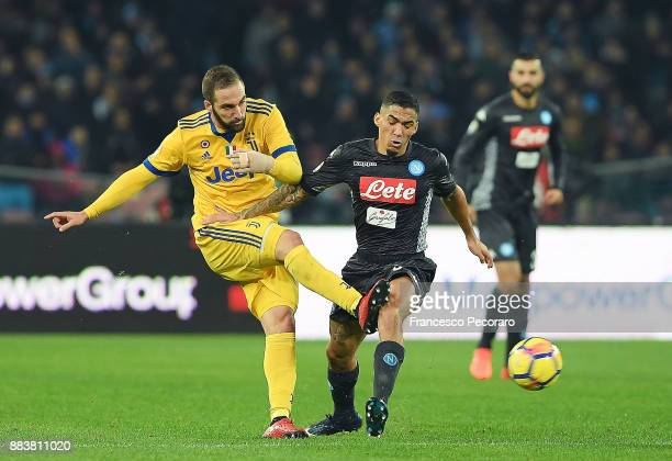 Player of SSC Napoli Allan vies with Juventus player Gonzalo Higuain during the Serie A match between SSC Napoli and Juventus at Stadio San Paolo on...