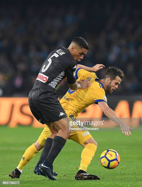Player of SSC Napoli Allan vies with Juventus player Miralem Pjanic during the Serie A match between SSC Napoli and Juventus at Stadio San Paolo on...