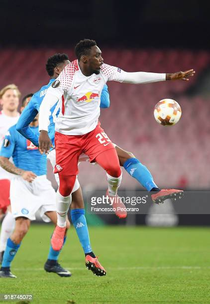 Player of SSC Napoli Amadou Diawara vies with RB Leipzig player JeanKevin Augustin during UEFA Europa League Round of 32 match between Napoli and RB...