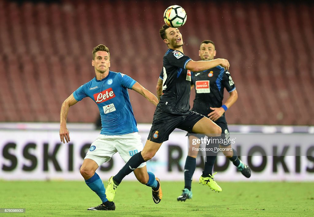 Player of SSC Napoli Arkadiusz Milik vies with Espanyol player during the pre-season friendly match between SSC Napoli and Espanyol at Stadio San Paolo on August 10, 2017 in Naples, Italy.