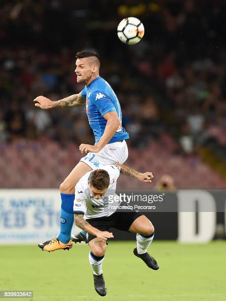 Player of SSC Napoli Christian Maggio vies with Atalanta BC player Papu Gomez during the Serie A match between SSC Napoli and Atalanta BC at Stadio...