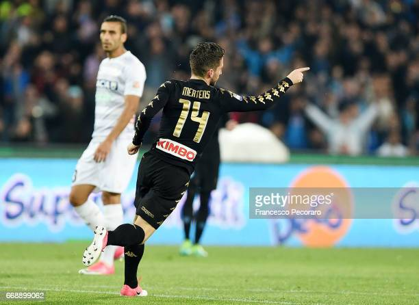 Player of SSC Napoli Dries Mertens celebrates after scoring the 10 goal beside the disappointment of Ali Adnan player of Udinese Calcio during the...