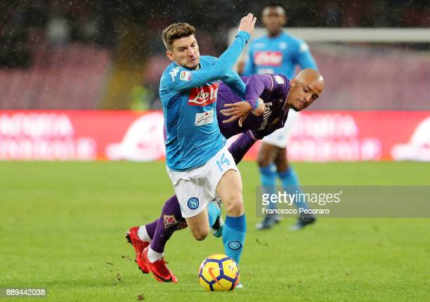 Player of SSC Napoli Dries Mertens vies with ACF Fiorentina player Bruno Gaspar during the Serie A match between SSC Napoli and ACF Fiorentina at...