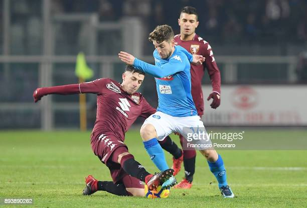 Player of SSC Napoli Dries Mertens vies with Torino FC player Daniele Baselli during the Serie A match between Torino FC and SSC Napoli at Stadio...