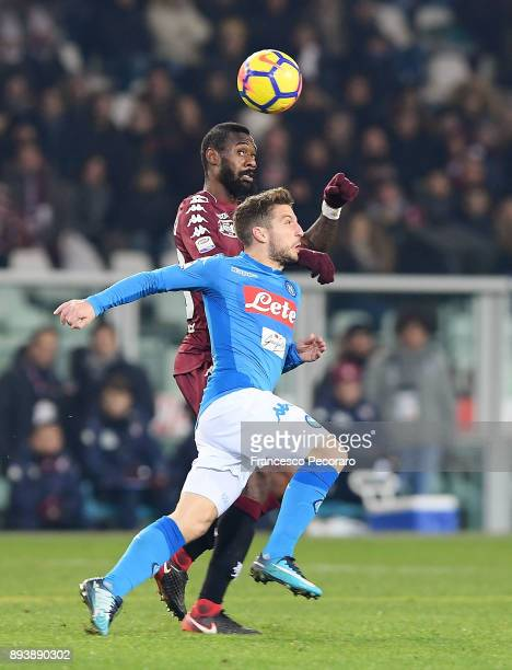Player of SSC Napoli Dries Mertens vies with Torino FC player Nicolas N'Nkoulou during the Serie A match between Torino FC and SSC Napoli at Stadio...