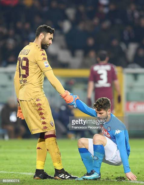 Player of SSC Napoli Dries Mertens vies with Torino FC player Salvatore Sirigu during the Serie A match between Torino FC and SSC Napoli at Stadio...