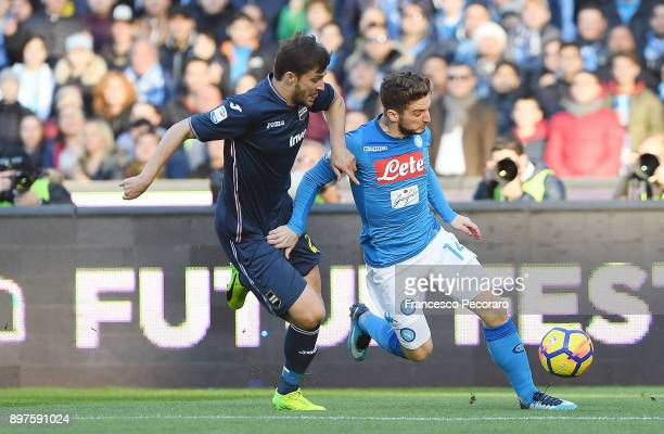 Player of SSC Napoli Dries Mertens vies with UC Sampdoria player Bartosz Bereszynski during the Serie A match between SSC Napoli and UC Sampdoria at...