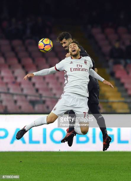 Player of SSC Napoli Elseid Hysaj vies with AC Milan player Manuel Locatelli during the Serie A match between SSC Napoli and AC Milan at Stadio San...
