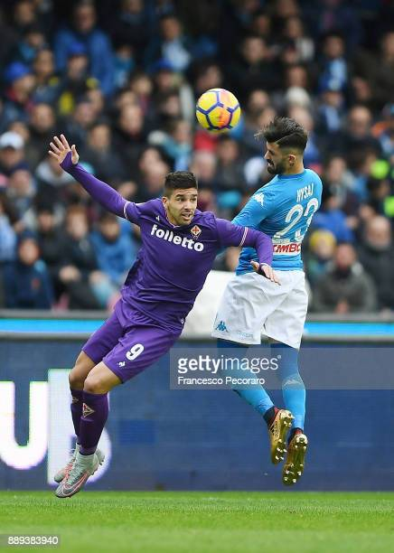 Player of SSC Napoli Elseid Hysaj vies with ACF Fiorentina player Giovanni Simeone during the Serie A match between SSC Napoli and ACF Fiorentina at...