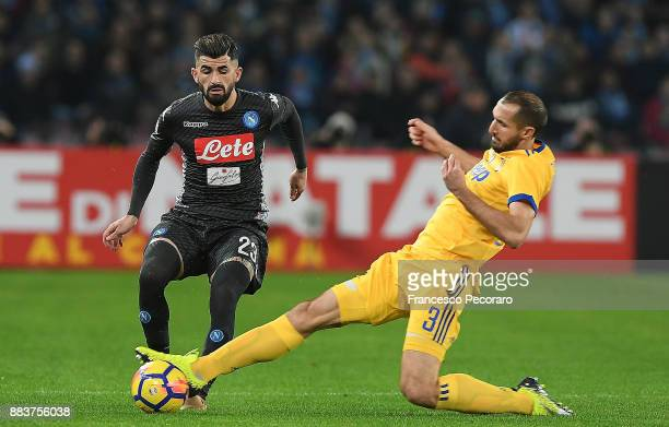 Player of SSC Napoli Elseid Hysaj vies with Juventus player Giorgio Chiellini during the Serie A match between SSC Napoli and Juventus at Stadio San...