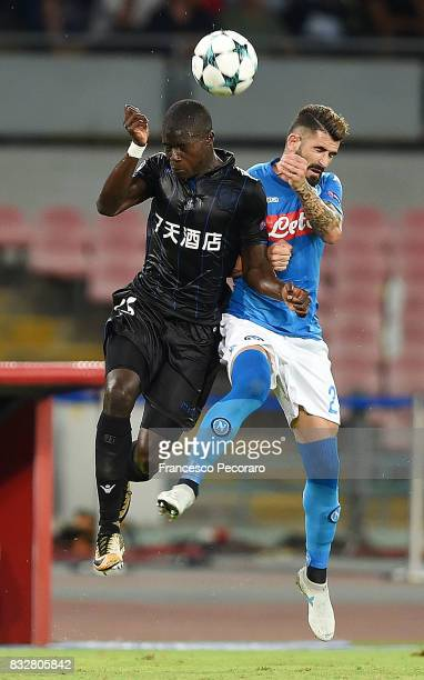 Player of SSC Napoli Elseid Hysaj vies with OGC Nice player Malang Sarr during the UEFA Champions League Qualifying Play-Offs Round First Leg match...