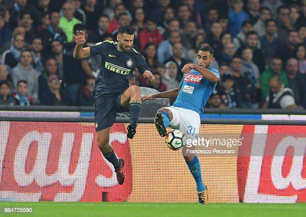 Player of SSC Napoli Faouzi Ghoulam vies with FC Internazionale player Antonio Candreva during the Serie A match between SSC Napoli and FC...