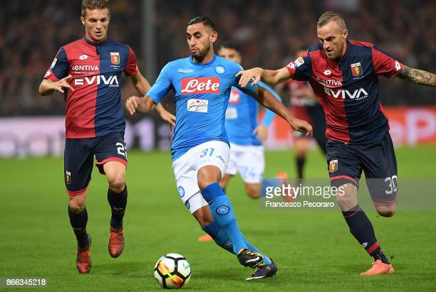 Player of SSC Napoli Faouzi Ghoulam vies with Genoa CFC players Darko Lazovic and Luca Rigoni during the Serie A match between Genoa CFC and SSC...