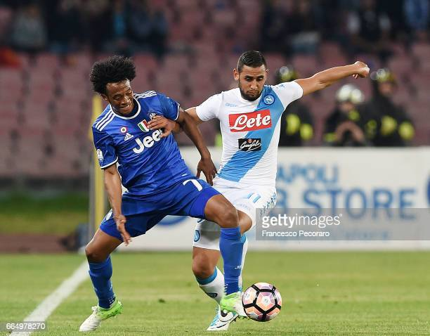 Player of SSC Napoli Faouzi Ghoulam vies with Juventus FC player Juan Cuadrado during the TIM Cup match between SSC Napoli and Juventus FC at Stadio...