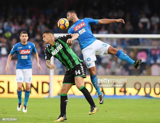 Player of SSC Napoli Faouzi Ghoulam vies with US Sassuolo player Gianluca Scamacca during the Serie A match between SSC Napoli and US Sassuolo at...