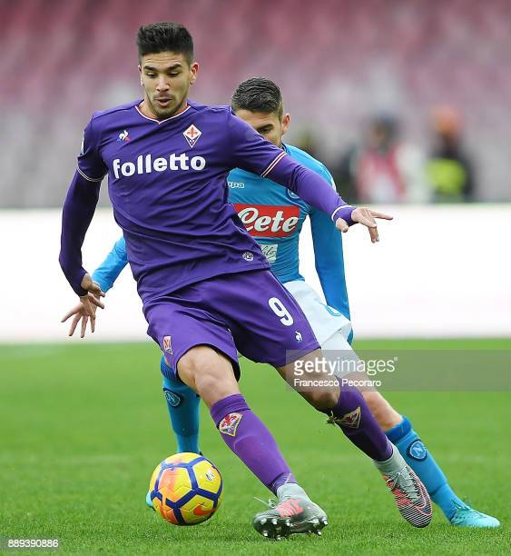 Player of SSC Napoli Jorginho vies with ACF Fiorentina player Giovanni Simeone during the Serie A match between SSC Napoli and ACF Fiorentina at...