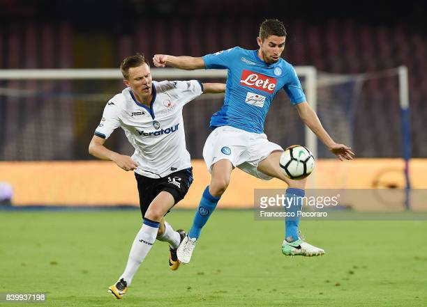 Player of SSC Napoli Jorginho vies with Atalanta BC player Josip Ilicic during the Serie A match between SSC Napoli and Atalanta BC at Stadio San...