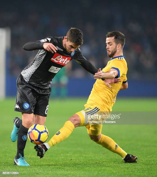 Player of SSC Napoli Jorginho vies with Juventus player Miralem Pjanic during the Serie A match between SSC Napoli and Juventus at Stadio San Paolo...