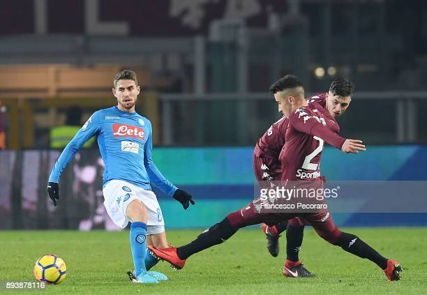 Player of SSC Napoli Jorginho vies with Torino FC players Daniele Baselli and Alex Berenguer during the Serie A match between Torino FC and SSC...