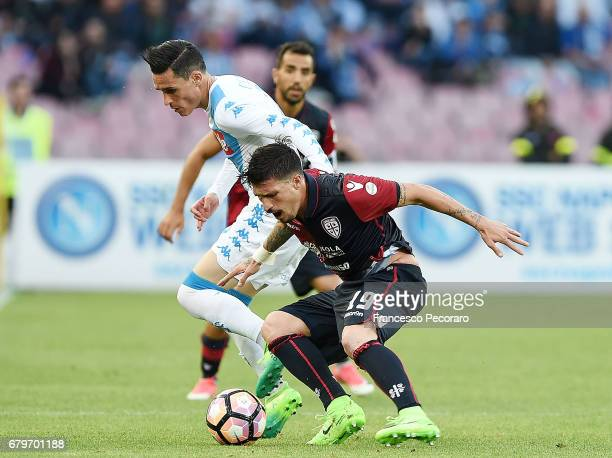 Player of SSC Napoli Jose Callejon Fabio Pisacane vies with Cagliari Calcio player Mauricio Isla during the Serie A match between SSC Napoli and...