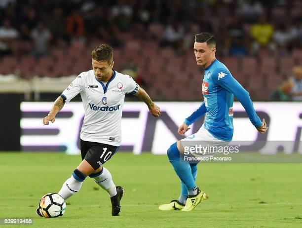 Player of SSC Napoli Jose Callejon vies with Atalanta BC player Papu Gomez during the Serie A match between SSC Napoli and Atalanta BC at Stadio San...