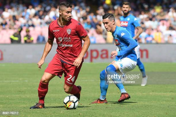 Player of SSC Napoli Jose Callejon vies with Cagliari Calcio player Marco Capuano during the Serie A match between SSC Napoli and Cagliari Calcio at...