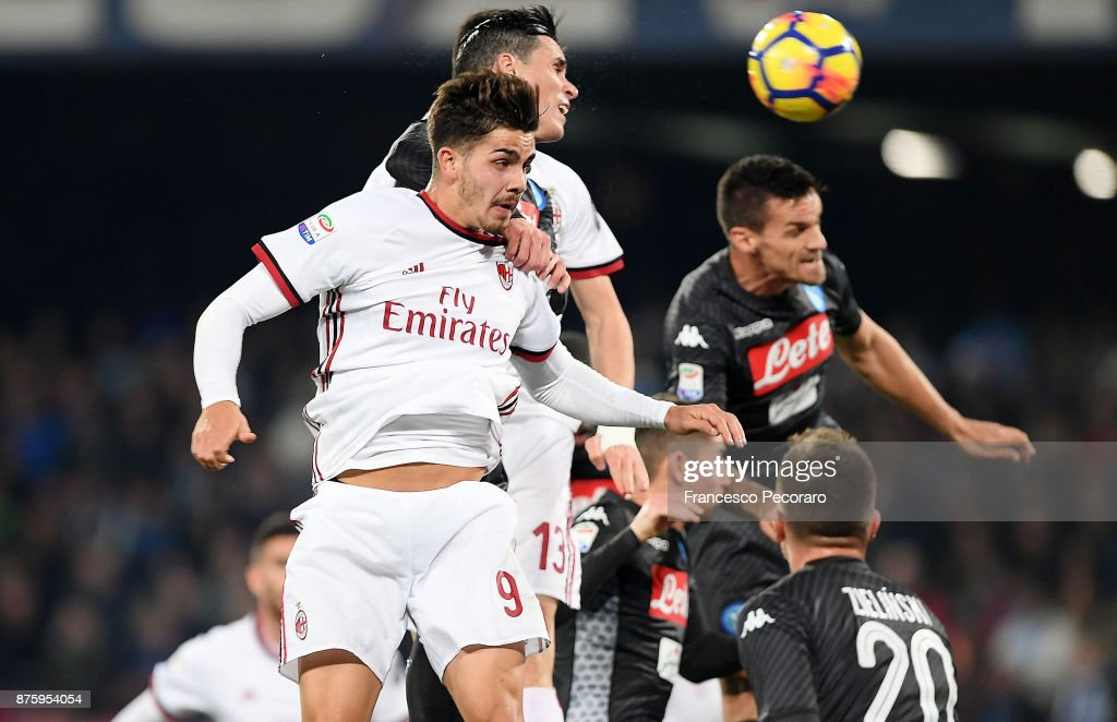 Player of SSC Napoli Jose Calleon vies with AC Milan player Andre Silva during the Serie A match between SSC Napoli and AC Milan at Stadio San Paolo on November 18, 2017 in Naples, Italy.