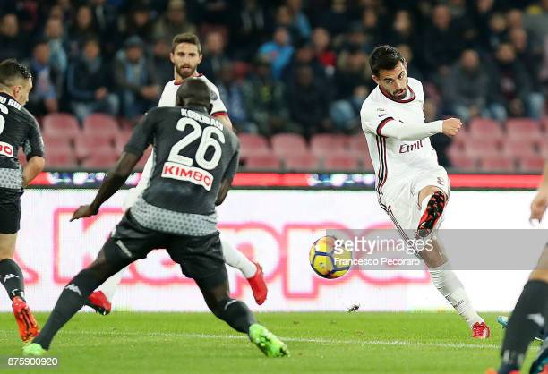 Player of SSC Napoli Kalidou Koulibaly vies with AC Milan player Suso during the Serie A match between SSC Napoli and AC Milan at Stadio San Paolo on...