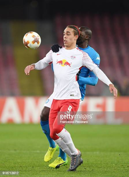 Player of SSC Napoli Kalidou Koulibaly vies with RB Leipzig player Yussuf Poulsen during UEFA Europa League Round of 32 match between Napoli and RB...