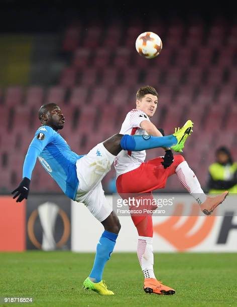 Player of SSC Napoli Kalidou Koulibaly vies with RB Leipzig player Timo Werner during UEFA Europa League Round of 32 match between Napoli and RB...